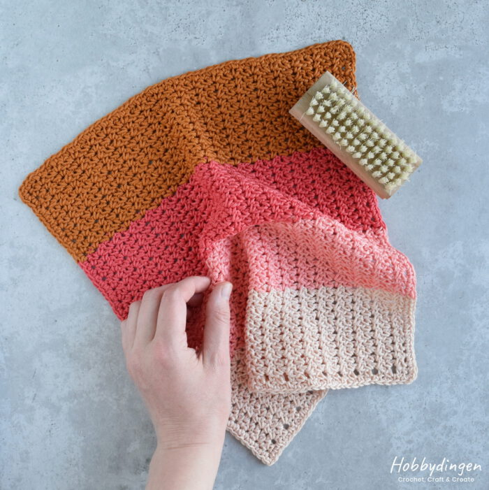 Colorful crocheted washcloth with 4 colors.